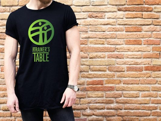 View of The Trainer's Table logo design on t shirt